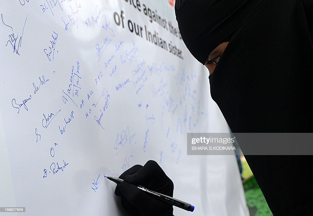 A Sri Lankan opposition United National Party activist places her signature on a banner in memory of an Indian gang rape victim, in Colombo on December 31, 2012. The family of an Indian gang-rape victim said they would not rest until her killers are hanged as they spoke of their own pain and trauma over a crime that has united the country in grief. AFP PHOTO/ Ishara S. KODIKARA