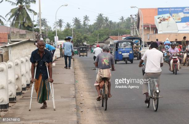 Sri Lankan people ride their bicycle in Colombo the capital of Sri Lanka on July 10 2017 An island country Sri Lanka is famous with its spice and tea...