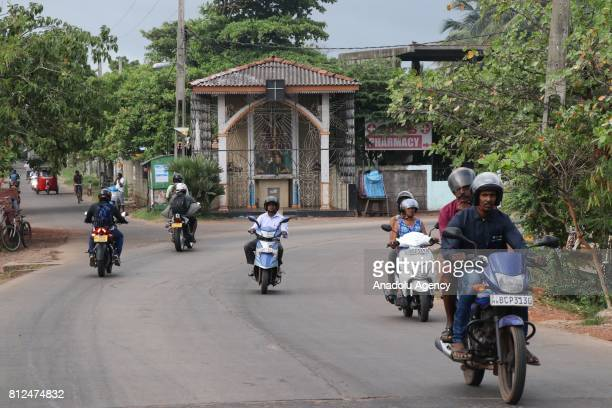 Sri Lankan people ride their motorcycle in Colombo the capital of Sri Lanka on July 10 2017 An island country Sri Lanka is famous with its spice and...