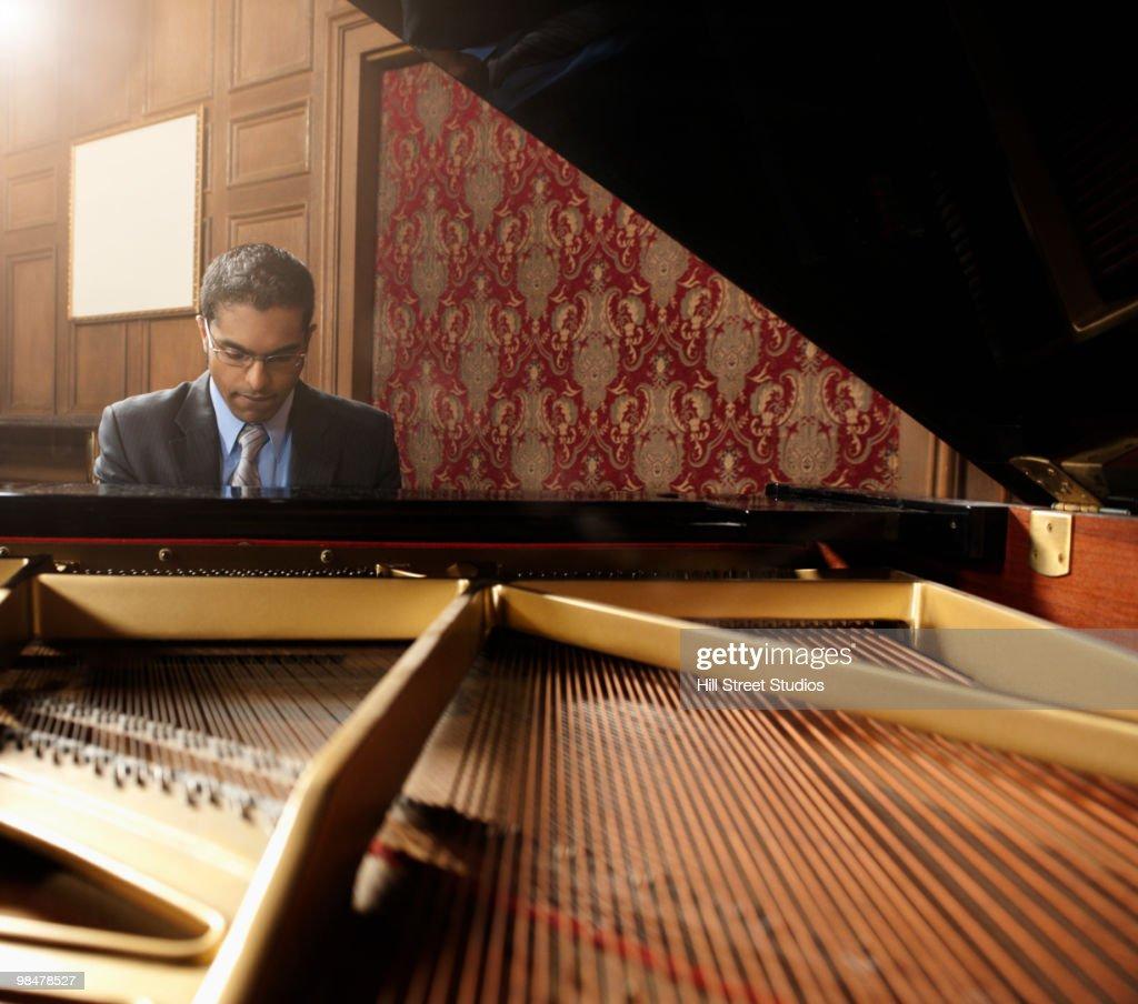 Sri Lankan pianist performing in nightclub