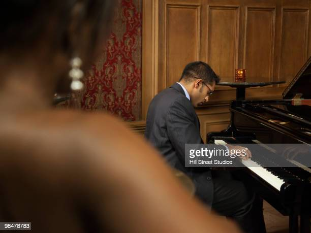 Sri Lankan pianist performing in nightclub