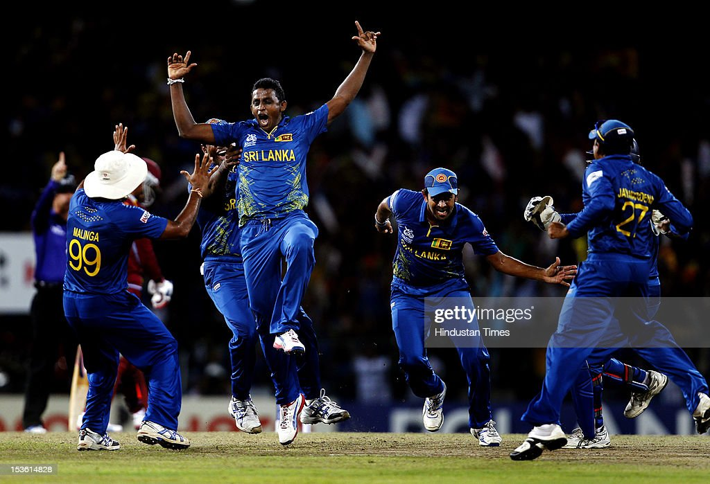 Sri Lankan player <a gi-track='captionPersonalityLinkClicked' href=/galleries/search?phrase=Ajantha+Mendis&family=editorial&specificpeople=5123004 ng-click='$event.stopPropagation()'>Ajantha Mendis</a> celebrates the dismissal of West Indies player Chris Gayle during the ICC World T20 Final between Sri Lanka and West Indies at R. Premadasa Stadium on October 7, 2012 in Colombo, Sri Lanka.