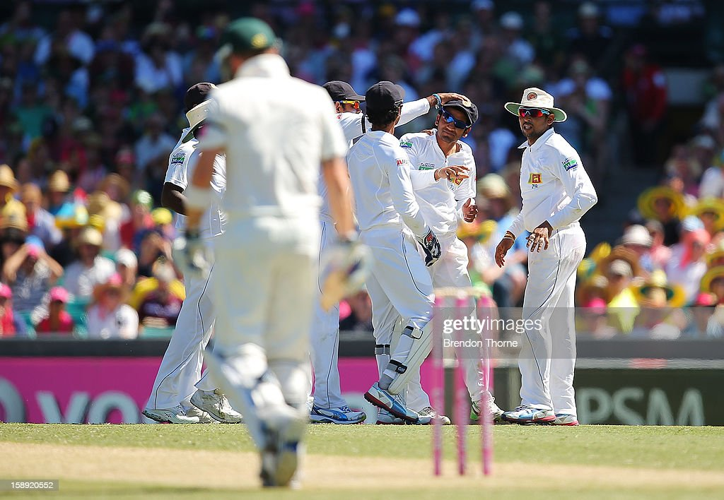 Sri Lankan players celebrate after Michael Hussey of Australia is run out during day two of the Third Test match between Australia and Sri Lanka at Sydney Cricket Ground on January 4, 2013 in Sydney, Australia.