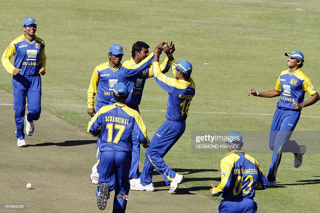 Sri Lankan players celebrate after Thissara Perera took the wicket of Indian batsman Dinesh Karthik at Harare Sports Club on June 5, 2010 in the fifth match of the Micromax Cup Triangular One-Day cricket series which is being hosted by Zimbabwe. AFP PHOTO / Desmond Kwande