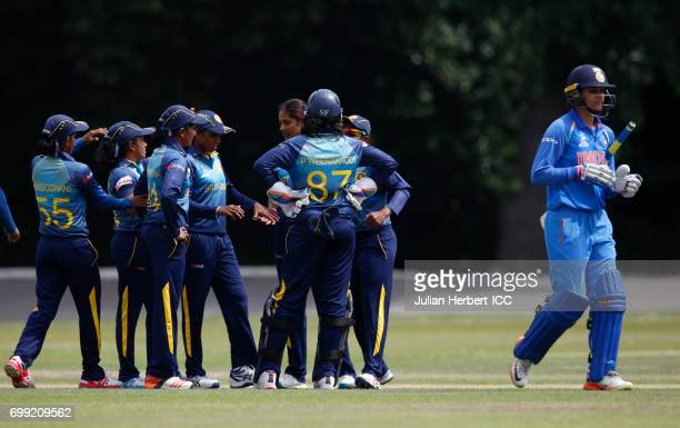 Sri Lankan players celebrate the wicket of Smriti Mandhana of India during The ICC Women's World Cup warm up match between India and Sri Lanka at...