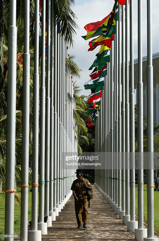 A Sri Lankan police officer walks in between flagpoles flying national flags ahead of the Commonwealth Heads of Government Meeting (CHOGM) at Bandaranaike Memorial International Conference Hall (BMICH) on November 9, 2013 in Colombo, Sri Lanka. The bi-annual gathering of Commonwealth leaders will take place in the Sri Lankan captial, Columbo, November 15-17. CHOGM will move forward despite some human rights groups urging leaders to boycott the meetings until Sri Lanka further investigates charges of war crimes. Canadian Prime Minister, Stephen Harper has already confirmed he will not attend.