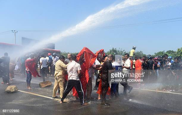 Sri Lankan police use a water canon to disperse activists and Buddhist during a protest in the southern port city of Hambantota on January 7 2017 Sri...