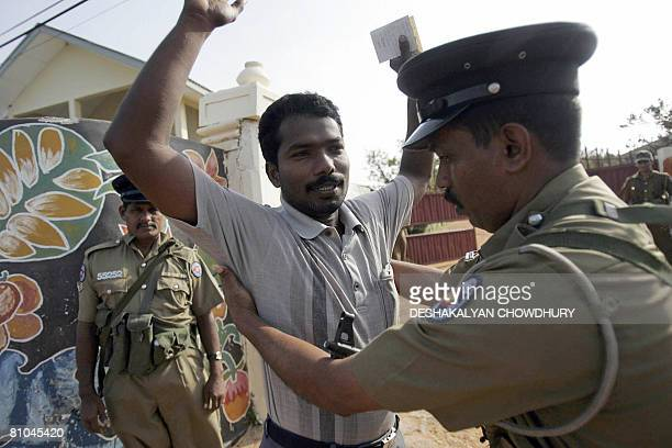 A Sri Lankan policeman frisks a voter at the entrance to a polling station in the eastern Sri Lankan province of Trincomalee on May 10 2008 Tamil...