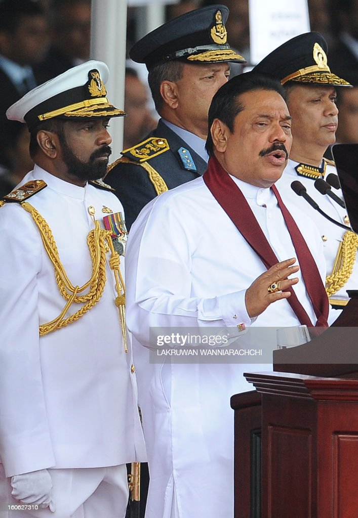 Sri Lankan President Mahinda Rajapakse (2nd R) addresses the nation during the country's 65th Independence Day celebrations in the northeastern town of Trincomalee on February 4, 2013. Sri Lanka marked its freedom anniversary with a thinly veiled denunciation of Western moves to pass a new resolution against the island at the UN Human Rights Council.