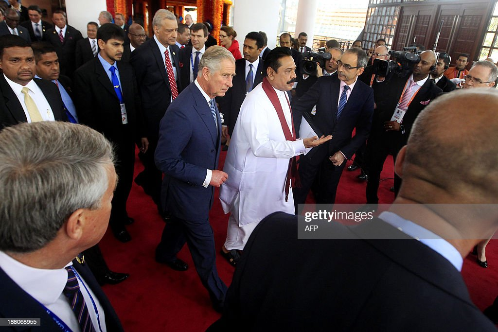 Sri Lankan President Mahinda Rajapaksa (C-R) and Britain's Prince Charles (C-L) leave after posing for the official photograph following the opening ceremony of the Commonwealth Heads of Government Meeting (CHOGM) in Colombo on November 15, 2013. Sri Lanka's president urged his peers not to pass judgment over his country's past as he hosted a Commonwealth summit that threatens to be upstaged by a visit to the war-torn north by Britain's David Cameron.