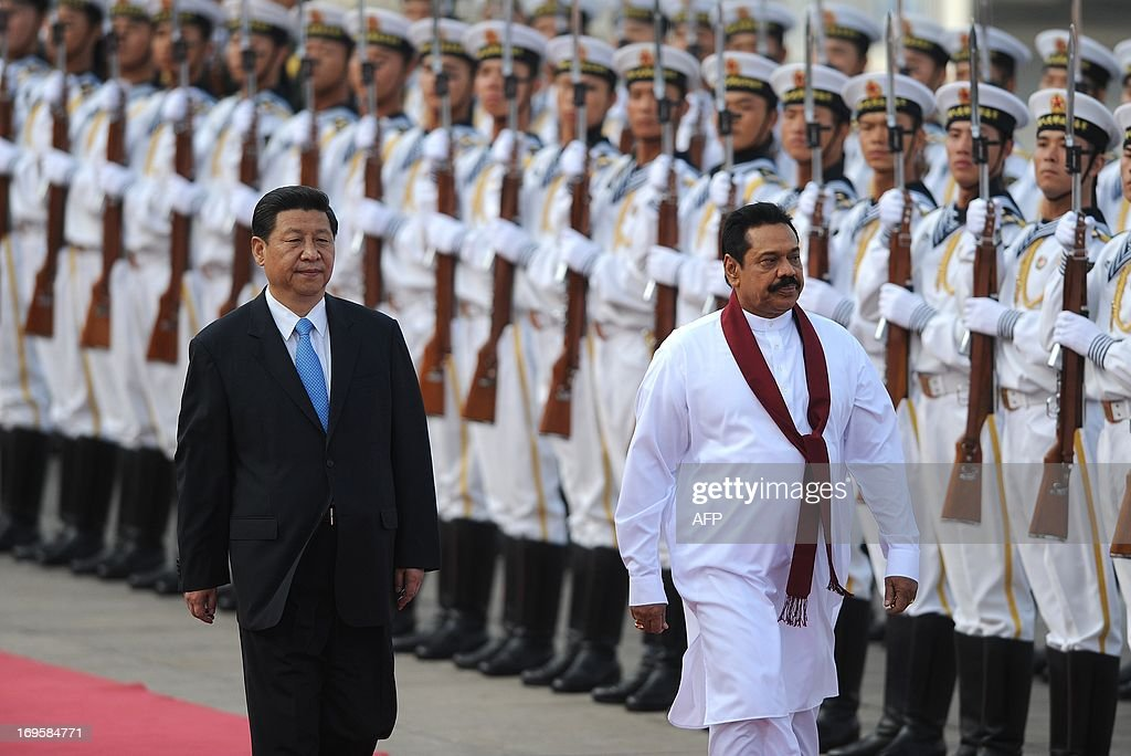 Sri Lankan President Mahinda Rajapaksa (R) and Chinese President Xi Jinping (L) inspect Chinese honour guards during a welcoming ceremony outside the Great Hall of the People in Beijing on May 28,2013. Mahinda Rajapaksa is on a two-day visit to China.