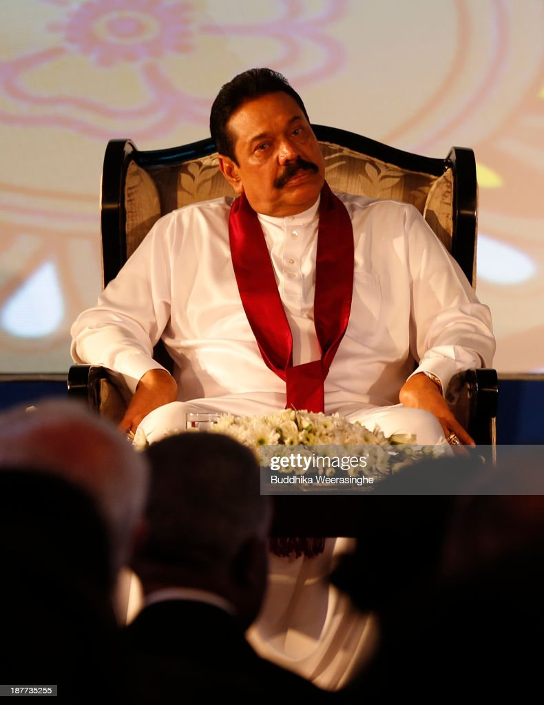 Sri Lankan President <a gi-track='captionPersonalityLinkClicked' href=/galleries/search?phrase=Mahinda+Rajapaksa&family=editorial&specificpeople=588377 ng-click='$event.stopPropagation()'>Mahinda Rajapaksa</a> attends the inaugural session of The Commonwealth Business Forum on November 12, 2013 in Colombo, Sri Lanka. The biennial Commonwealth Heads of Government Meeting (CHOGM) will take place from November 15-17, amidst pressure from human rights groups urging leaders to boycott the summit until Sri Lanka further investigates charges of war crimes. Both the Canadian Prime Minister, Stephen Harper and Indian Prime Minister, Manmohan Signh have confirmed they will not attend.