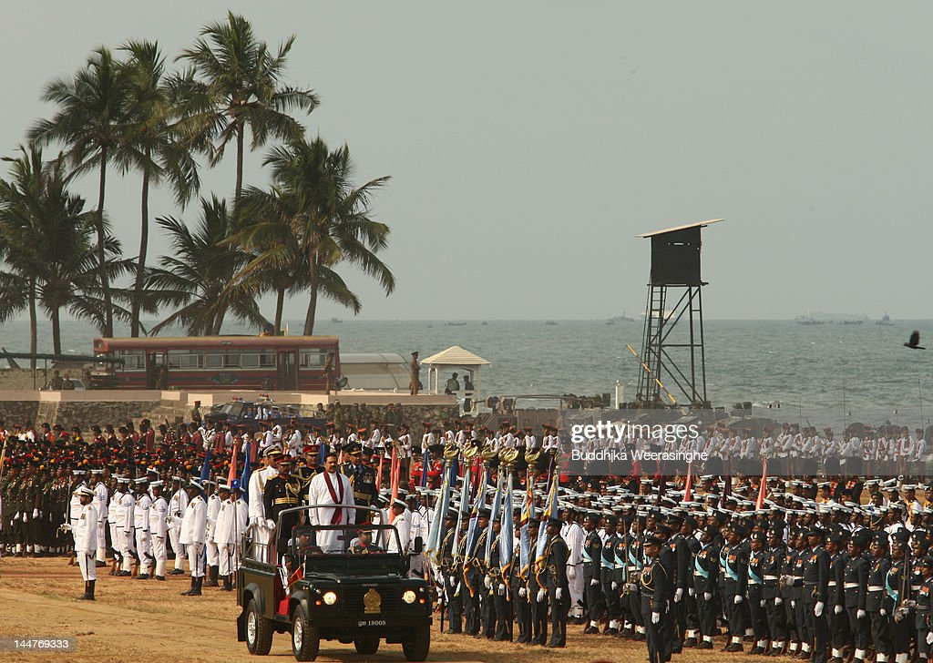 defeat in war. sri lankan president mahinda rajapaksa inspects the military parade commemorating third anniversary of end defeat in war o