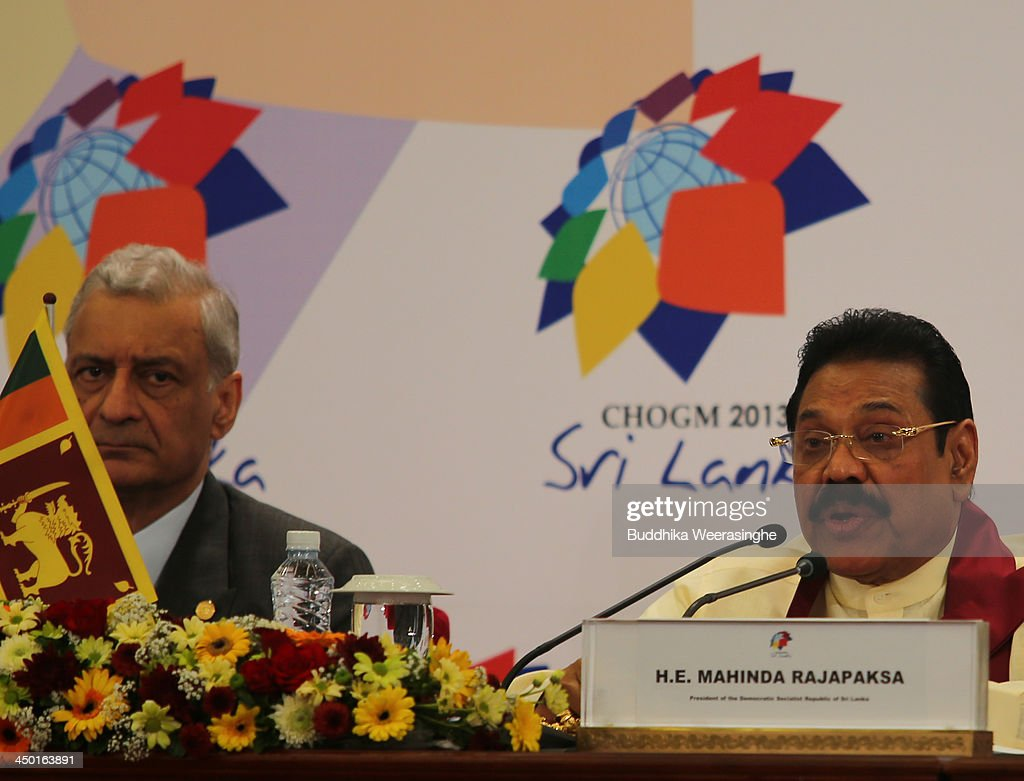 Sri Lankan President Mahinda Rajapaksa (R) speaks to journalists as Commonwealth Secretary General Kamalesh Sharma looks during the press conferance on the final day of the Commonwealth Heads of Government Meeting (CHOGM) on November 17, 2013 in Colombo, Sri Lanka. The biennial summit of Commonwealth leaders was attended by over 5000 delegates including the Prince of Wales and the Duchess of Cornwall.