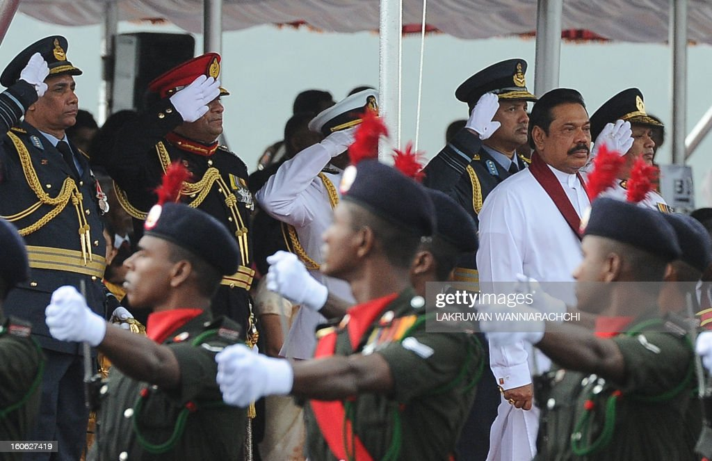 Sri Lankan President Mahinda Rajapakse (2nd R) watches a military parade during the country's 65th Independence Day celebrations in the northeastern town of Trincomalee on February 4, 2013. Sri Lanka marked its freedom anniversary with a thinly veiled denunciation of Western moves to pass a new resolution against the island at the UN Human Rights Council.