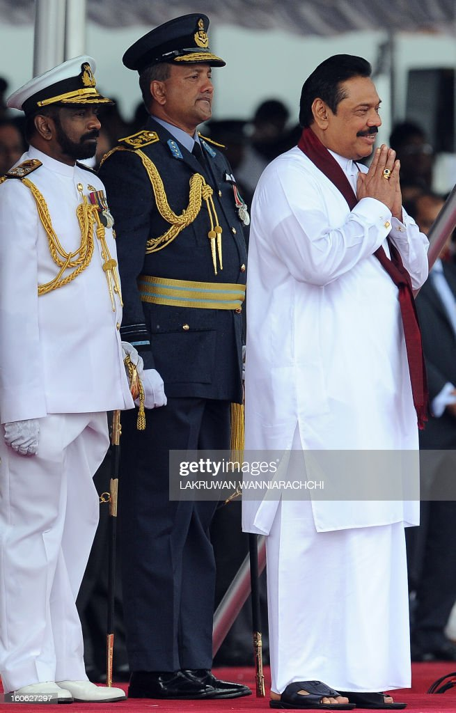 Sri Lankan President Mahinda Rajapakse (R) with military commanders attend the country's 65th Independence Day celebrations in the northeastern town of Trincomalee on February 4, 2013. Sri Lanka marked its freedom anniversary with a thinly veiled denunciation of Western moves to pass a new resolution against the island at the UN Human Rights Council.