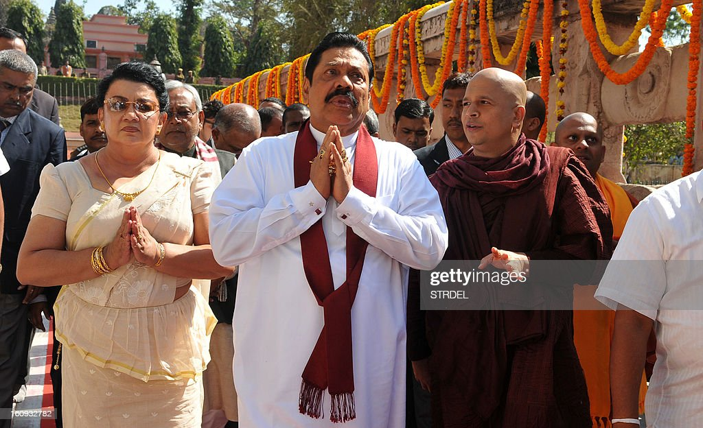 Sri Lankan President Mahinda Rajapakse (C) gestures as he prays near a holy Bodhi tree at the World Heritage Mahabodhi temple in Bodhgaya on February 8, 2013. President Mahinda Rajapakse is on a personal visit to India during which he will offer prayers at Bodhgaya and Tirupathi but will not engage with Indian leaders.