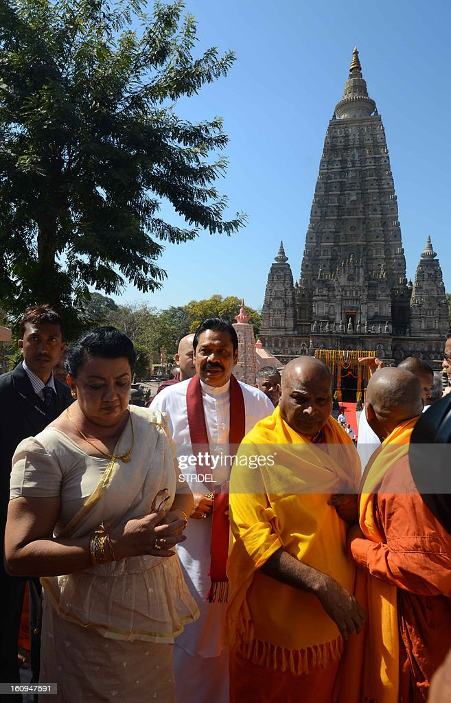 Sri Lankan President Mahinda Rajapakse (C) visits the World Heritage Mahabodhi temple in Bodhgaya on February 8, 2013. President Mahinda Rajapakse is on a personal visit to India during which he will offer prayers at Bodhgaya and Tirupathi but will not engage with Indian leaders.