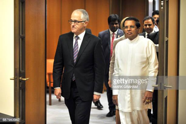 Sri Lankan President Maithripala Sirisena and Australian Prime Minister Malcolm Turnbull arrive at Parliament House in Canberra on May 25 2017 / AFP...