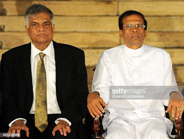 Sri Lankan President Maithripala Sirisena and Sri Lankan Prime Minister Ranil Wickremasinghe pose for photographers following the swearingin ceremony...