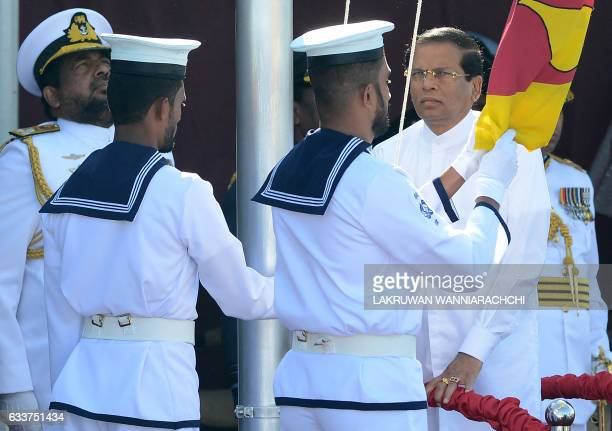 Sri Lankan President Maithripala Sirisena hoists the national flag during the island's 69th Independence Day celebrations in Colombo on February 4...