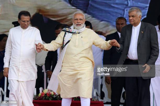 Sri Lankan President Maithripala Sirisena left Indian Prime Minister Narendra Modi center and Sri Lankan Prime Minister Ranil Wickremesinghe hold...