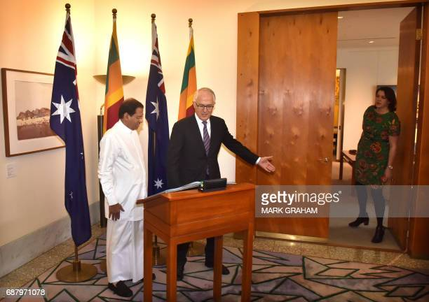 Sri Lankan President Maithripala Sirisena meets with Australian Prime Minister Malcolm Turnbull at Parliament House in Canberra on May 25 2017 / AFP...