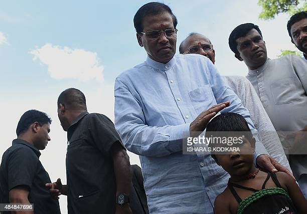 Sri Lankan President Maithripala Sirisena meets with minority Tamil residents in the eastern town of Muttur on August 22 2015 Sirisena visited the...