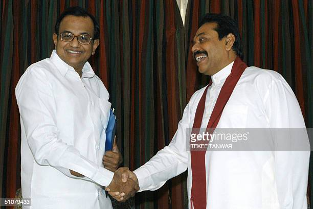 Sri Lankan Prime Minister Mahinda Rajapakse shakes hands with India's Finance Minister P Chidambaram prior to a meeting in New Delhi 18 July 2004...