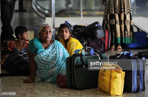 Sri Lankan refugees arrive home after returning from India at the Bandaranaike International airport in Katunayake on May 13 2015 Sri Lankan families...