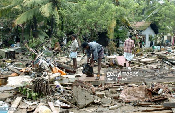 Sri Lankan residents pick throught debris caused by a massive tidal wave in the southern district of Galle 27 December 2004 Sri Lanka launched a...