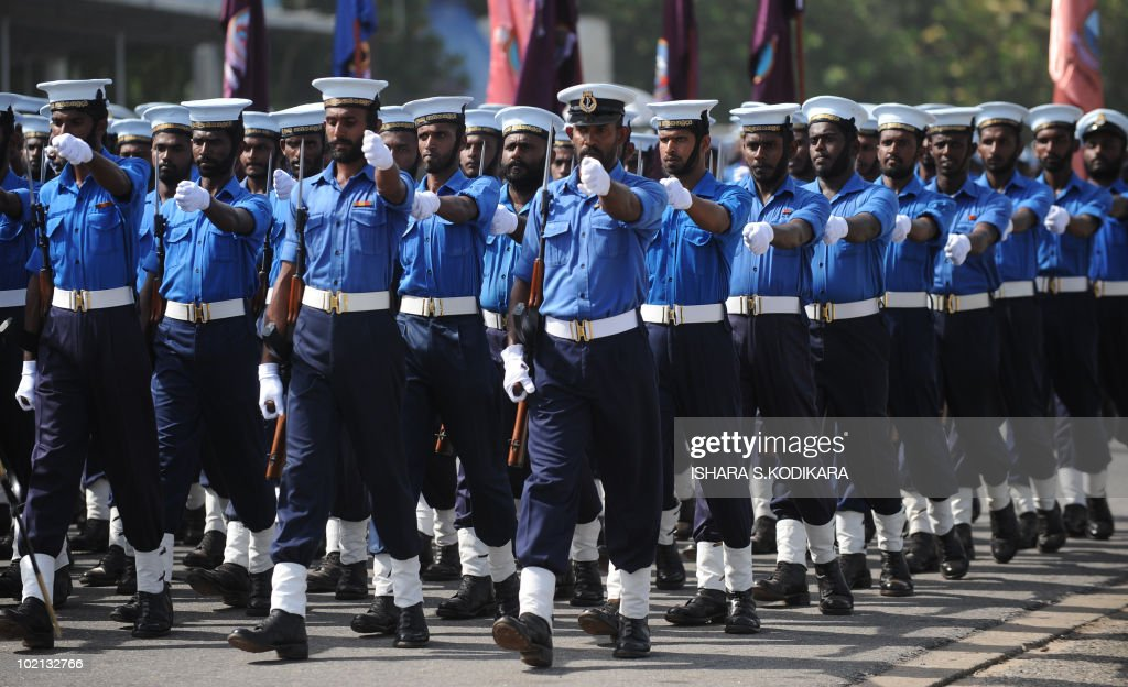 Sri Lankan sailors march during a rehearsal in Colombo on June 16, 2010. Security forces are preparing for June 18 celebrations of Sri Lanka's military victory over Tamil Tiger rebels last May, which ended the 37-year ethnic conflict. AFP PHOTO/Ishara S. KODIKARA