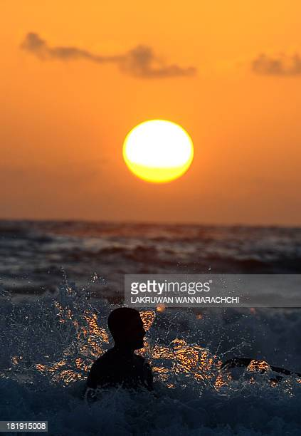 Sri Lankan schoolchildren play on a beach at sunset in Colombo on September 26 2013 Sri Lanka's youth population aged 10 to 19 make up some 15...
