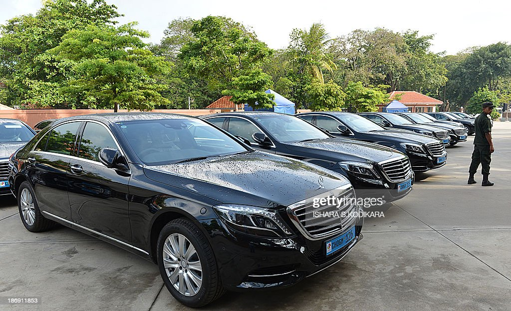 A Sri Lankan soldier is pictured near a fleet of new MercedesBenz S400 hybrid cars parked at a performing arts centre in Colombo on November 5, 2013, to be used by heads of government attending the 53-member Commonwealth summit in Sri Lanka from November 1517. The centre named after President Mahinda Rajapakse will host the opening of the Commonwealth Heads of Government Meeting (CHOGM) which is boycotted by Canadas Prime Minister Steven Harper who is protesting the islands human rights record. AFP PHOTO/Ishara S. KODIKARA