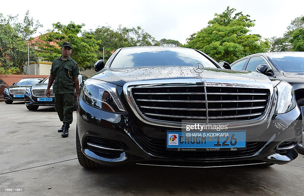 A Sri Lankan soldier walks past a fleet of new MercedesBenz S400 hybrid cars parked at a performing arts centre in Colombo on November 5, 2013, to be used by heads of government attending the 53-member Commonwealth summit in Sri Lanka from November 1517. The centre named after President Mahinda Rajapakse will host the opening of the Commonwealth Heads of Government Meeting (CHOGM) which is boycotted by Canadas Prime Minister Steven Harper who is protesting the islands human rights record. AFP PHOTO/Ishara S. KODIKARA