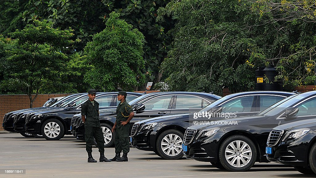 Sri Lankan soldiers are pictured near a fleet of new MercedesBenz S400 hybrid cars parked at a performing arts centre in Colombo on November 5, 2013, to be used by heads of government attending the 53-member Commonwealth summit in Sri Lanka from November 1517. The centre named after President Mahinda Rajapakse will host the opening of the Commonwealth Heads of Government Meeting (CHOGM) which is boycotted by Canadas Prime Minister Steven Harper who is protesting the islands human rights record. AFP PHOTO/Ishara S. KODIKARA