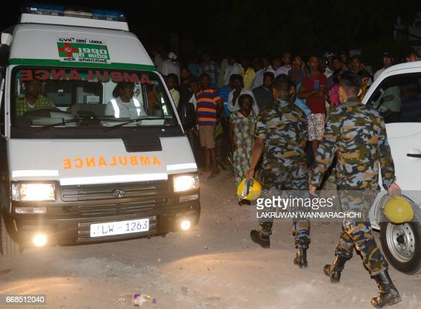 Sri Lankan soldiers arrive to help in the rescue operations at the site of a garbage dump in Colombo on April 14 following a massive rubbish dump...