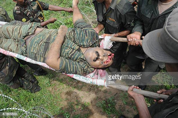 OUT Sri Lankan soldiers carry the remains of Tamil Tiger Leader Velupillai Prabhakaran in the district of Mullaittivu on May 19 2009 Sri Lanka marked...