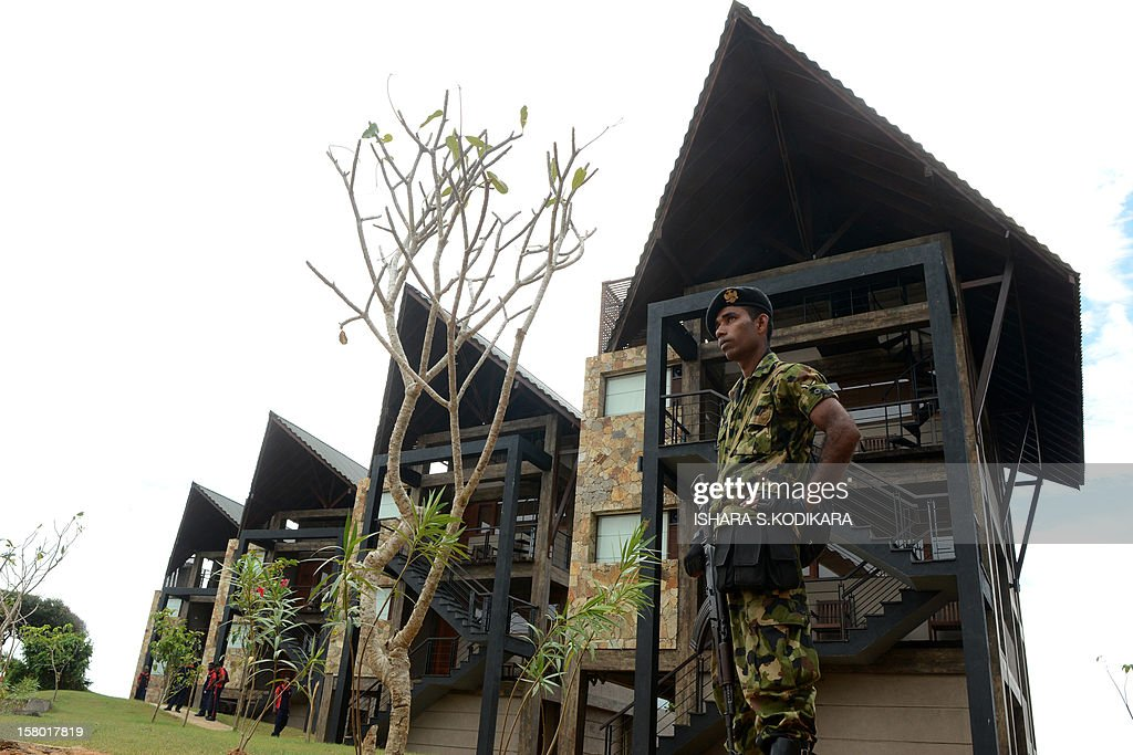 A Sri Lankan special forces commando stands guard during the opening of the 'Laya Safari Hotel ' built by the army in the southern coast of Yala on December 9, 2012. The military run 20-room 'Laya Safari Hotel ' overlooks the Indian Ocean and is close to the Yala National Park that is popular to spot leopards. AFP PHOTO/Ishara S