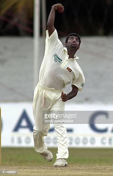 Sri Lankan spin bowler Muttiah Muralitharan throws a ball during the first day of the first Test match between Sri Lanka and Bangladesh at the PSara...
