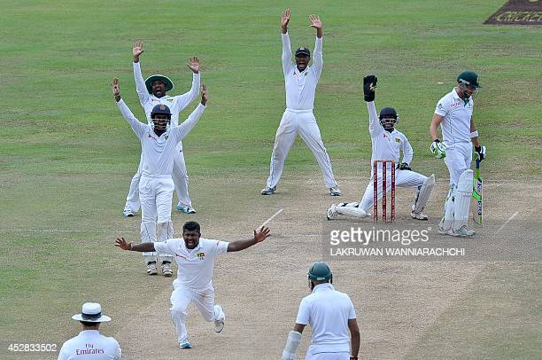 Sri Lankan spinner Rangana Herath and teammates appeal unsuccessfully for the wicket of South African cricketer Faf du Plessis during the final day...