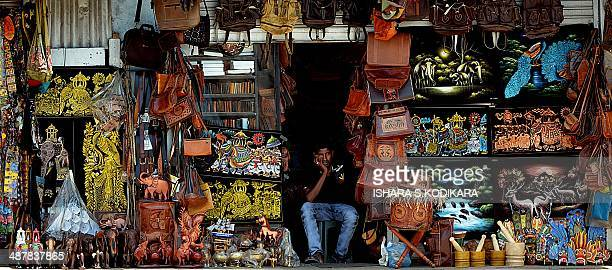A Sri Lankan street vendor sits at the entrance of his shop on May 2 2014 in Colombo Sri Lanka's economy recorded 80 percentplus growth for two...