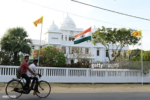 A Sri Lankan Tamil man cycles past a public library in Jaffna some 400 kilometres north of Colombo on March 13 2015 Narendra Modi who urged Sri...