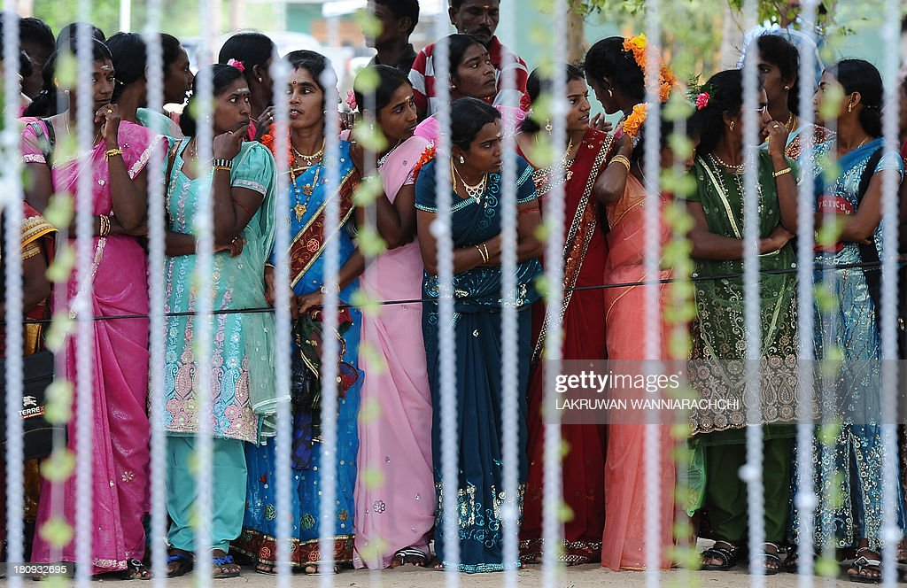 Sri Lankan Tamil woman look on during a wedding the northern Sri Lanan town of Kilinochchi Sept 18 at a ceremony arranged by the paramilitary Civil...