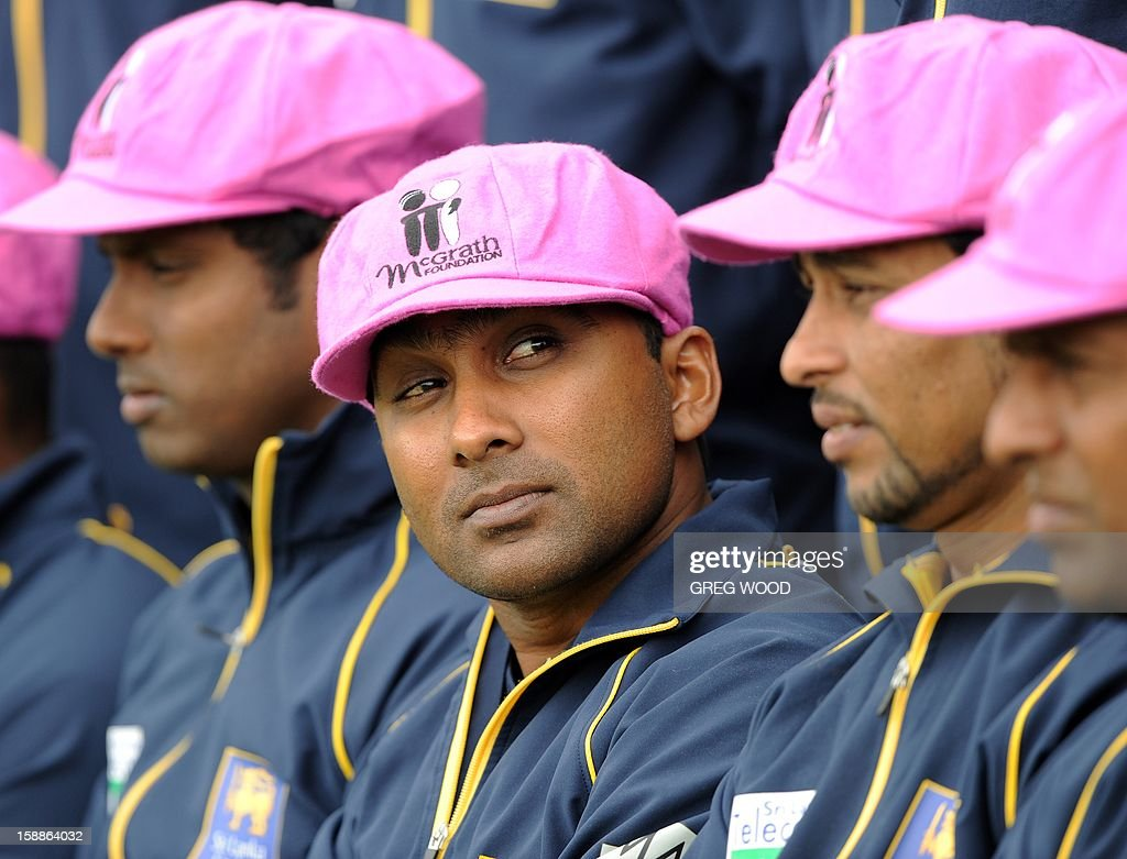 Sri Lankan Test cricket captain Mahela Jayawardene (C) joins teammates all wearing 'Baggy Pink' caps in aid of the McGrath Foundation, during a team photo at the Sydney Cricket Ground on the eve of the third cricket Test between Sri Lanka and Australia in Sydney on January 2, 2013. IMAGE AFP PHOTO / Greg WOOD