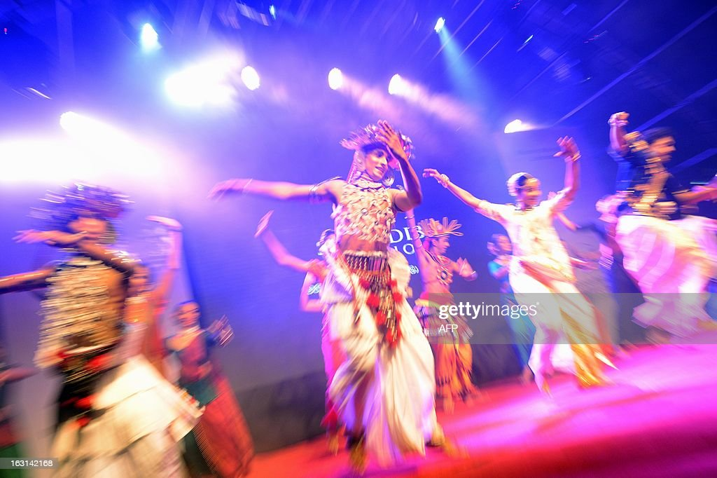 Sri Lankan traditional dancers perform during the launch of a website for the state-run film studios in the southern district of Hambantota on March 5, 2013. The president has pledged to turn the arid region, his home constituency, into a new commercial and arts capital of the country emerging from nearly four decades of ethnic bloodshed. AFP PHOTO / Ishara S. KODIKARA