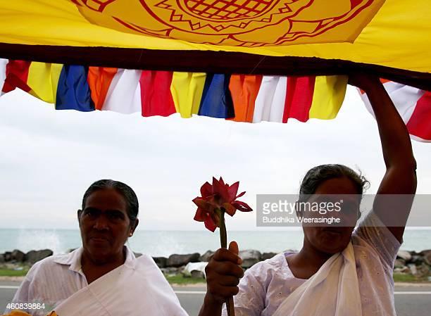Sri Lankan tsunami survivor women attend a Buddhist religious ritual procession as they pray for tsunami victims to commemorate the tenth anniversary...