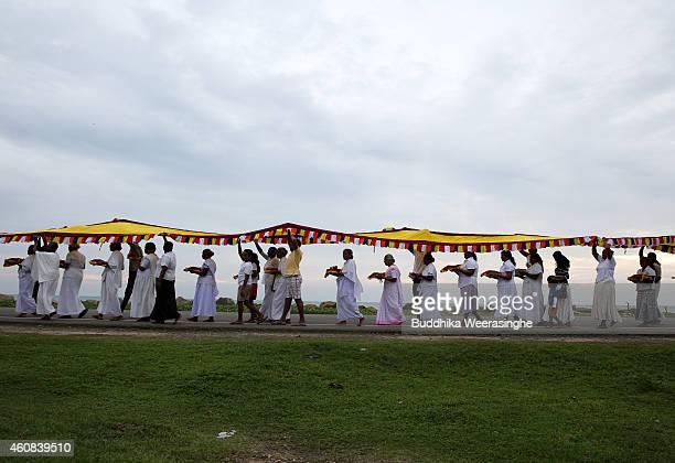 Sri Lankan tsunami survivors attend a Buddhist religious ritual to prey for tsunami victims to commemorate the tenth anniversary of the Boxing Day...