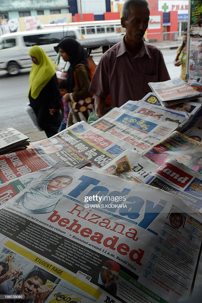 A Sri Lankan vendor displays the front page of daily newspapers in Colombo on January 10, 2013. Saudi Arabia beheaded a Sri Lankan maid on Wednesday after she was convicted of murdering her employer's baby, drawing sharp condemnation from Colombo which had repeatedly urged a stay of execution. AFP POHOTO/ Ishara S.KODIKARA