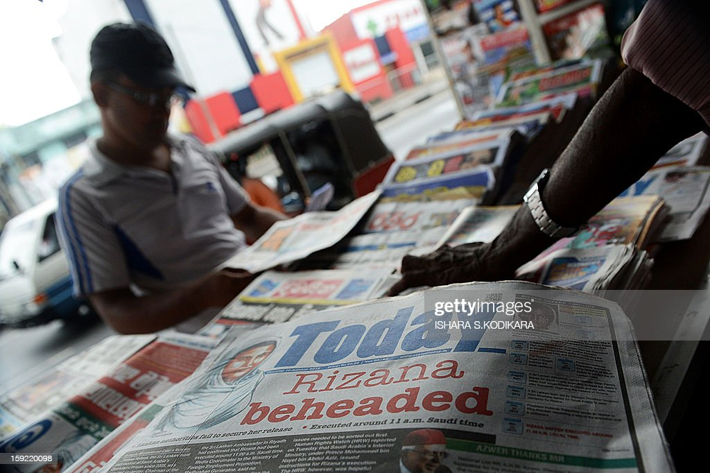 A Sri Lankan vendor displays the front page of daily newspapers in Colombo on January 10, 2013. Saudi Arabia beheaded a Sri Lankan maid on Wednesday after she was convicted of murdering her employer's baby, drawing sharp condemnation from Colombo which had repeatedly urged a stay of execution. AFP POHOTO/ Ishara S